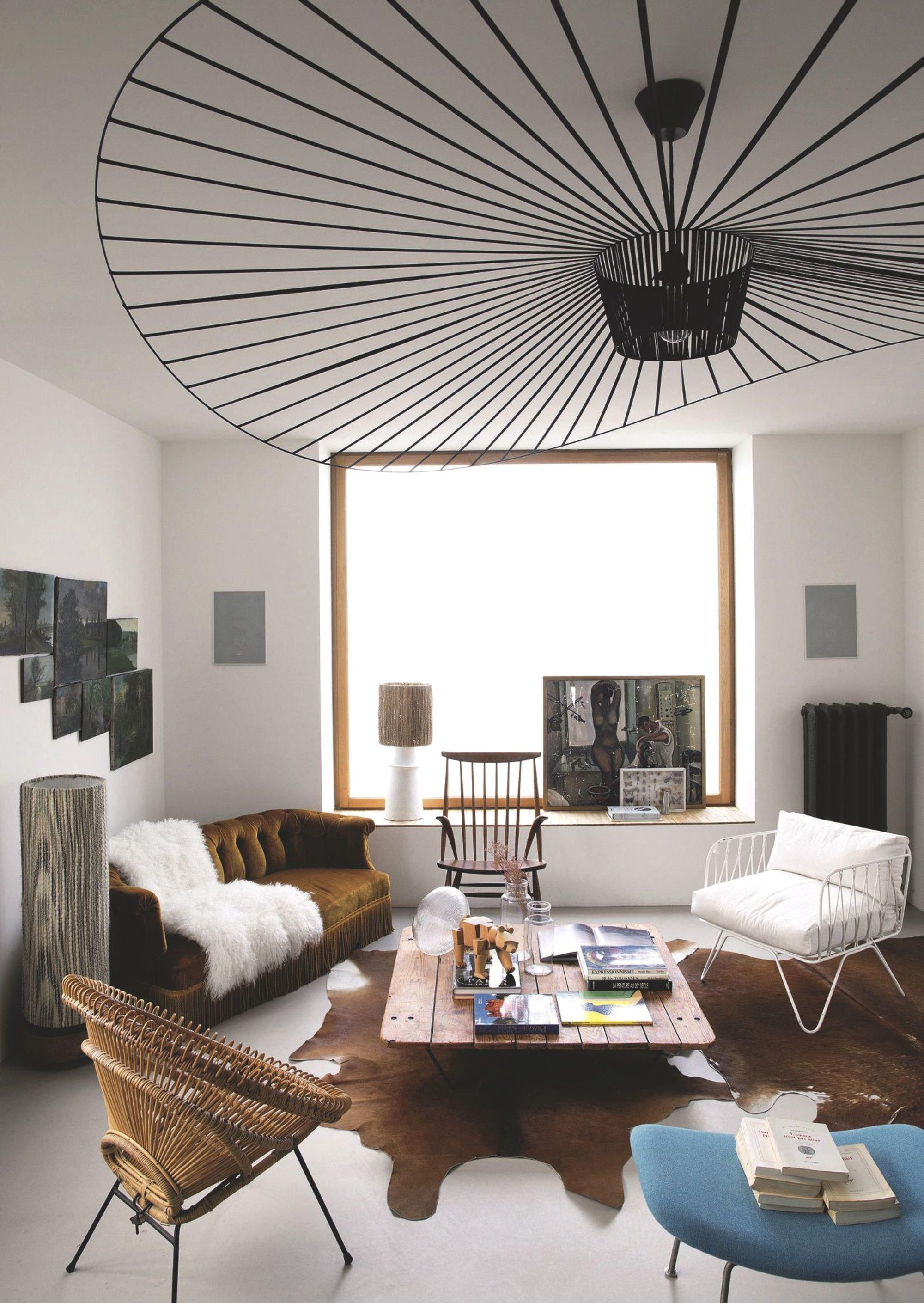 Salon ethnique vintage vert marron noir bleu bois métal rotin textile cuir