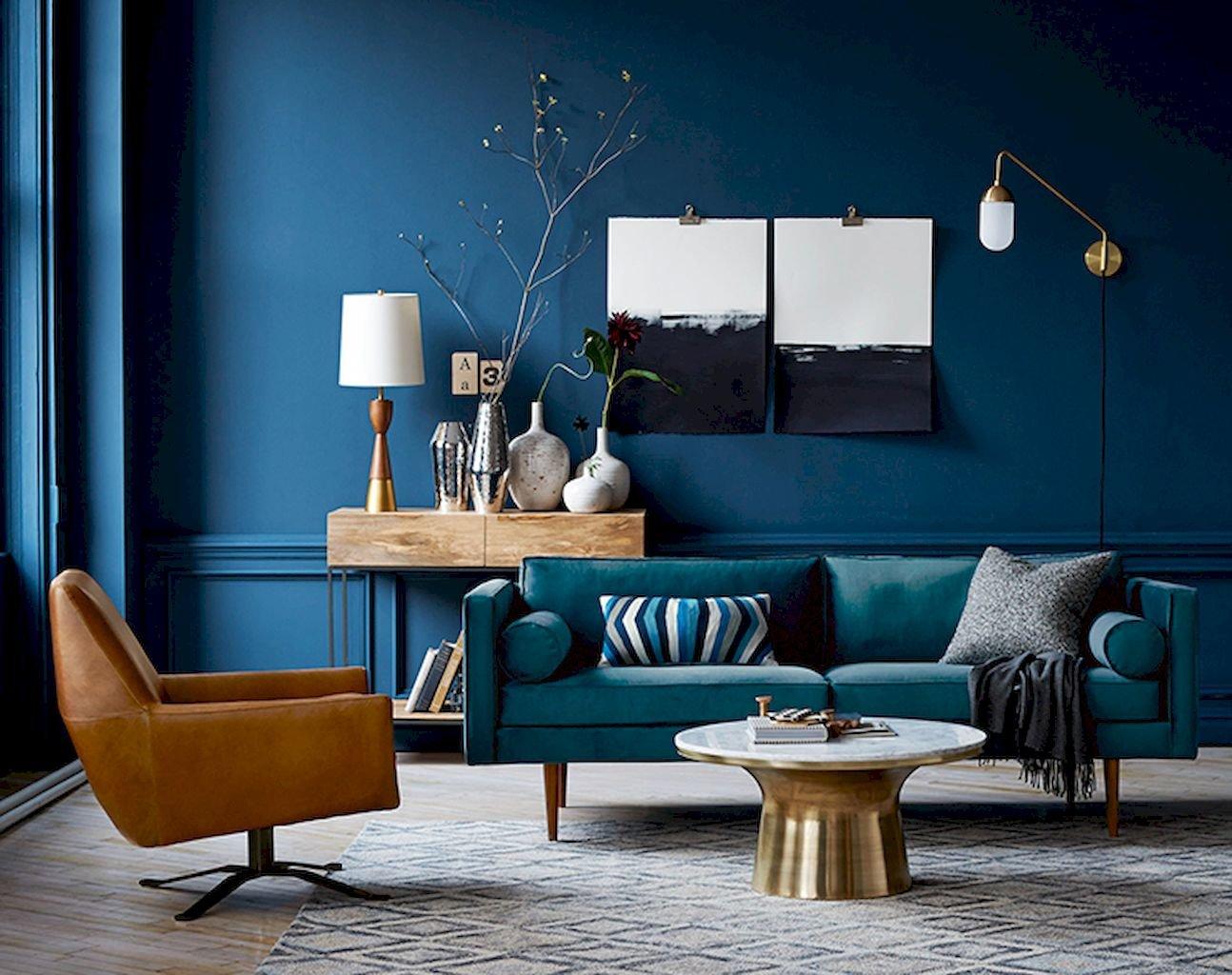 Salon scandinave bleu marron doré bois cuir